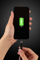 Hand charging phone with low battery