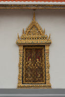 Decorative gold Grand Palace window with shutters