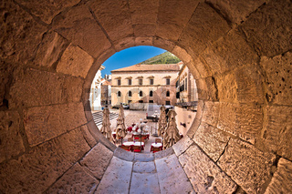 Dubrovnik historic street view through stone carved window