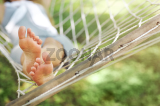 Young woman relaxing on hammock