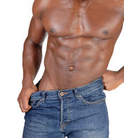 The close up torso of a black man bodybuilder in jeans