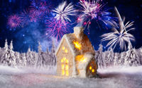 Small house with winter landscape and fireworks