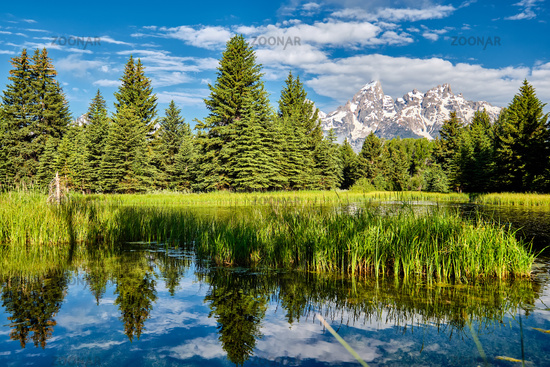 Mountains in Grand Teton National Park with reflection in Snake River