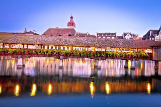 Kapellbrucke historic wooden bridge in Luzern and waterfront landmarks dawn view