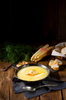 delicious asparagus cream soup with prawns and fresh dill
