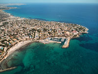Aerial image drone point of view turquoise bay of Mediterranean Sea waters and coastline Cabo Roig Torrevieja from above at summer, Province of Alicante, Costa Blanca, Spain