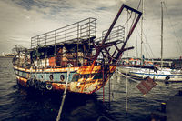 Old, rusty and abandoned ship