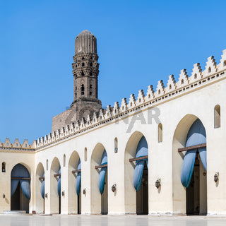 Minaret of historic Al Hakim Mosque known as The Enlightened Mosque, Moez Street, Old Cairo, Egypt