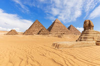 Beautiful view of the Pyramids and the Sphinx in Giza desert, Egypt