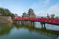 Matsumoto Castle with the red bridge in Nagano, Japan