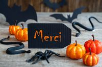 Black Label, Text Merci Means Thank You, Scary Halloween Decoration
