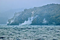 Hot Volcanic Lava Ffalls Into Sea.