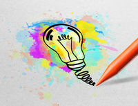 Pencil drawing colorful bulb on paper