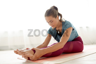 woman doing yoga exercise at studio