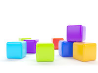 Colorful plastic cubes on a white background.