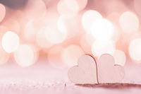 Pink hearts on bokeh background