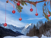 Christmas decoration in front of Waxenstein mountain on a sunny winter day
