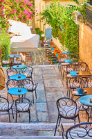Street cafe on the stairs in Plaka in Athens