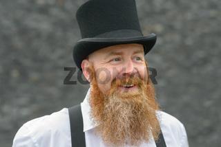 Happy redheaded man chuckling to himself