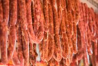 Sausages hanging in a market