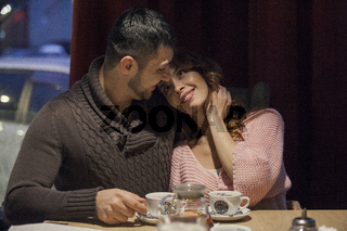 Couple having a good time in a cafe.