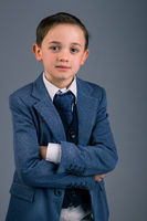 Boy dressed in suit for special event