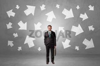 Businessman standing with arrows around