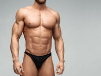 Bodybuilder man with perfect abs, shoulders,biceps, triceps and chest.