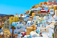 Houses of different colours in Santorini