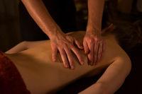 Masseur hands doing massage in spa center