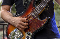 Hands playing eletric bass