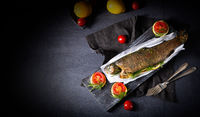 baked trout with herb filling and tomatoes