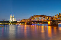 The famous Cologne Cathedral and the Hohenzollern railway bridge at night