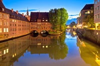 Holy Spirit Hospital evening view (Heilig-Geist-Spital) on river Pegnitz in Nuremberg