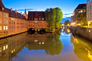 Holy Spirit Hospital evening view (Heilig-Geist-Spital) on river Pegnitz in Nuremberg