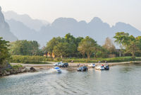 Washing cars in the river, Vang Vieng