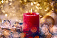 Red candle with christmas decoration