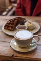 Cup of cappuccino with chocolate waffles