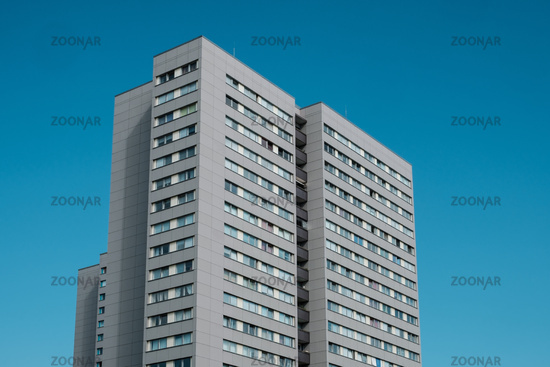 high rise apartment building on blue sky  -
