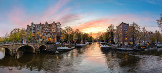 Amsterdam Netherlands, sunset panorama city skyline at canal waterfront