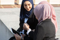Muslim business women discussing and handshake