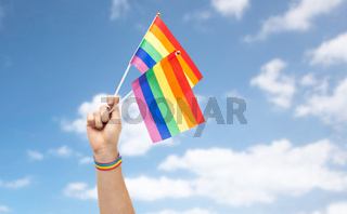 hand with gay pride rainbow flags and wristband