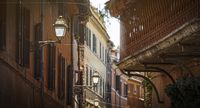 glimpse of an alley of Trastevere in Rome with ancient buildings