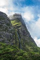 Cascata do Poço do Bacalhau, a waterfall on the Azores island of Flores, Portugal.