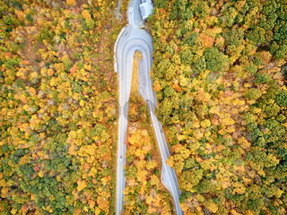 Scenic highway hairpin turn in autumn