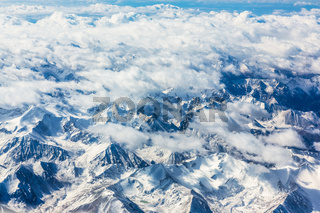 View of the mountains from airplane window during flight