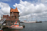 Pilot house at the harbor in the background Museum ship Gorch Fock