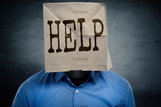 Businessman with a paper bag on ahis head