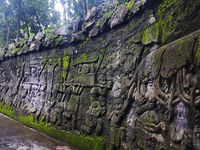 Carvings of stories from Balinese mythology on the walls near the entrance in Monkey Forest, Ubud, Bali, Indonesia.