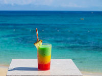 Multicolored cocktail with Blue Sky in background